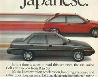 "1986 Mitsubishi / Dodge Colt Original 1985 Vintage Print Ad Color Photo Red Two Door, Gray Four Door Turbo Premier ""Speed Read Japanese"""
