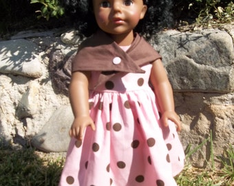 Cotton Candy Pink with Chocolate Brown polka dots. The perfect dress that any 18 inch doll will love to model.