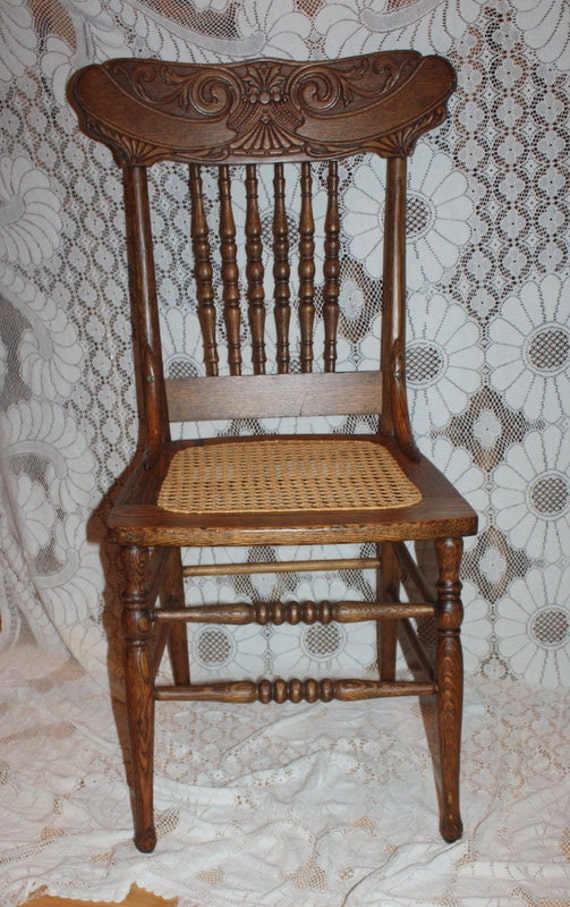 Beautiful pressed back wood chair oak with cane seat
