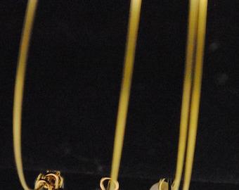 Gold bangle trio