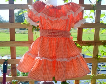 Peasant style dress,with lace and sash.Girls orange gingam check