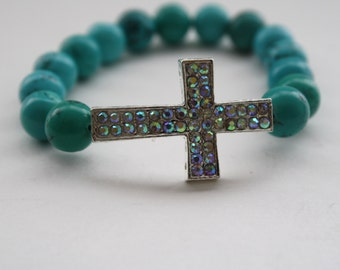 Silver Sideway Rhinestone Cross Bracelet On A Stretchy Cord With Round Turquoise Blue  Beads