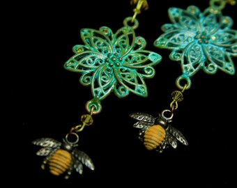 Flower earrings.  Hand painted patina to look vintage.  Swarovski crystal accent,