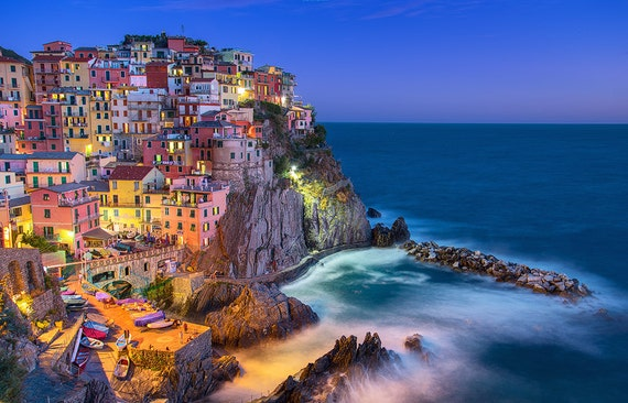 Manarola, built on a high rock 230ft above sea level, is one of the most charming and romantic of the Cinque Terre villages. The tiny harbor features a boat ramp, picturesque multicolored houses facing the sea, and a tiny piazza with seafood restaurants.