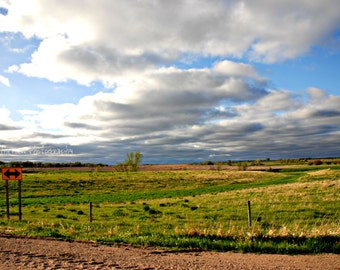 Nebraska Sign. Choose your path. Pasture with green grass, hills, and clouds.  Landscape Scenic Fine Art Photography