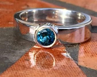 Sterling Silver Ring w/ Blue Topaz Bezel Set Center Stone