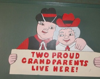 Two Proud Grandparents Live Here