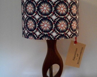 Handmade lampshade using Liberty Ebb and Flo (repeated circular and star pattern) in navy blue, red and white