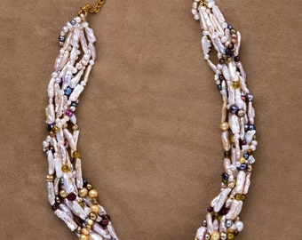 Baroque Pearl necklace swirled with gemstones and colored pearls: