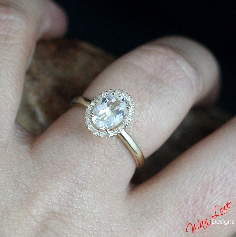 white topaz oval halo engagement ring by