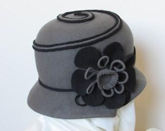 Grey cloche hat, 100% wool felt with felt flower and a black felt swirl design