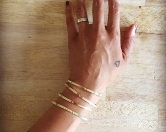 SALE a song on your arm, pixies style - a stack of four cuff bracelets