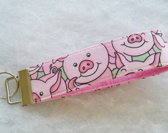 Key Fob wristlet -  Pink Pigs with green background