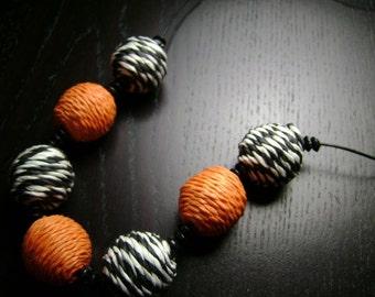 Black and Orange Raffia Bead Necklace on Black Leather Cord