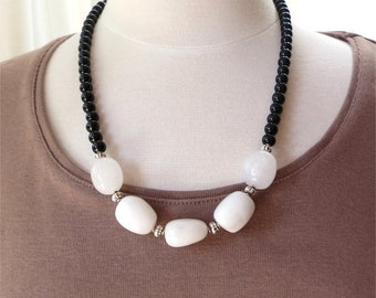 Necklace white and black mid-length.