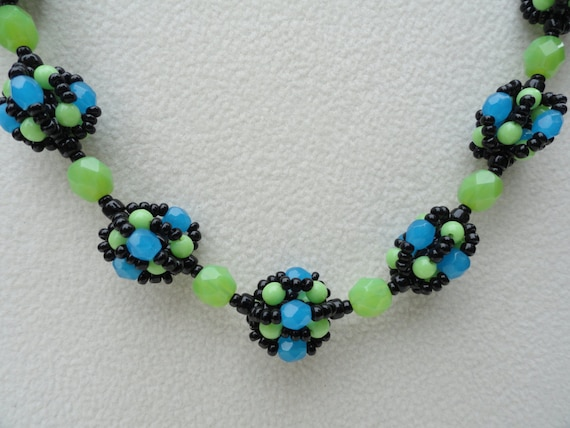 beaded bead necklace in green blue and black bead by