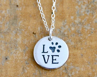 Paw print necklace with Love.