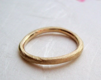 simple rough band in solid 10k yellow gold- mark of the maker- wedding ring