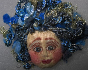 Whimsical fiber sculpted fairy face pin
