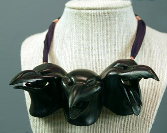 Crow necklace three laughing, Dyed Black  wood sculpture by Jason Tennant