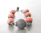 coral hue wire wrap bracelet, kazuri bead and sterling silver bracelet, rustic chunky bracelet