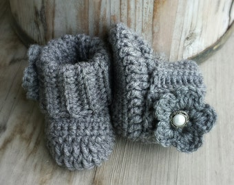 Crochet baby girl boots, in charcoal grey with flower and pearl button center. size 0 to 3 mo.