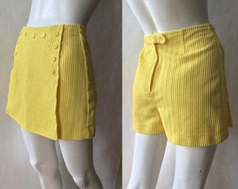 1960's button front tennis skirt / shorts, in textured yellow tone on tone striped knit with sailor style button front, small ( 4 - 6 )