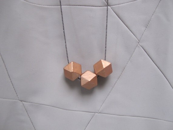 geometric necklace with copper faceted wooden beads on a puristic fine ballchain