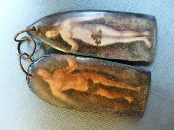 Adam and Eve. Resin shrine charm asymmetrical earring pair.