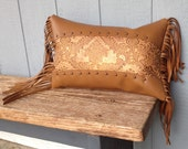Fringe leather pillow with embossed metallic leather inset