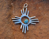 PTPGZ Turquoise and Sterling Silver Petroglyph Drawing Zia Symbol Pendant