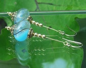 Baby blue swirl glass ball earrings
