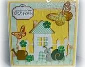 A new home, fun handmade card with cute garden scene.