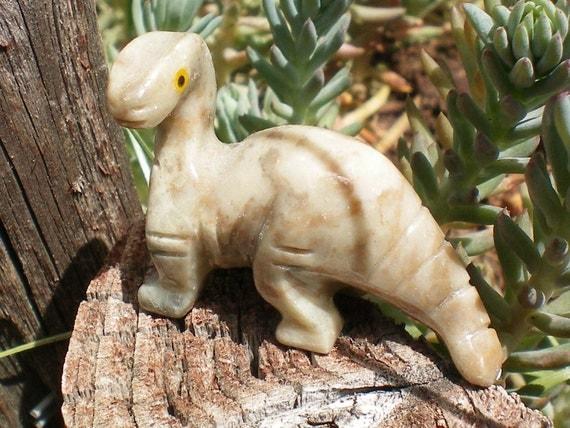 Dinosaur carved stone