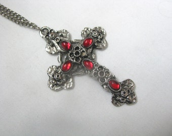 Hammered metal cross pendant necklace with oval red cab accents