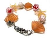 SALE - Lampwork Glass Seashell Bracelet. Golden Amber. Summer Bracelet. Silver Plated. 7.5 Inch Bracelet.