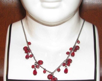 Antique necklace with ruby red glass beads