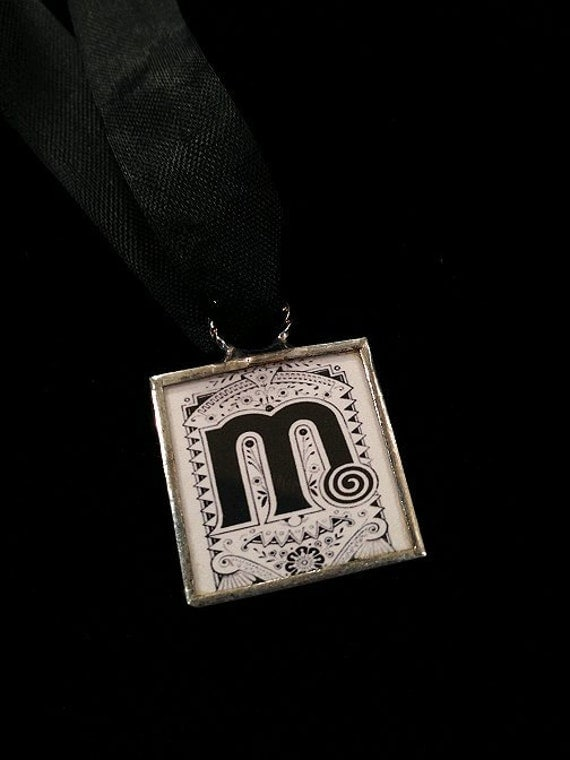 M initial monogram letter vintage aesthetic Victorian typeset necklace pendant on ribbon