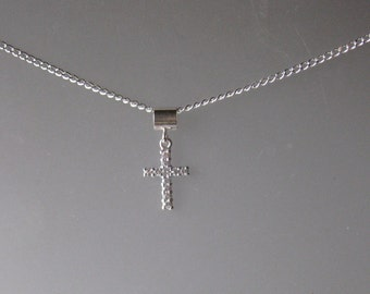 Small CZ Cross Necklace on a Diamond Cut Sterling Curb Chain
