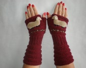 Hand-knitted pair of burgundy color wrist warmers with hand needlecrafted sheep