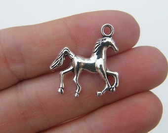 8 Horse charms antique silver tone A603