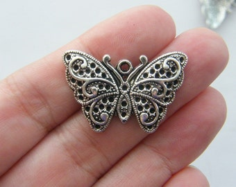 4 Butterfly charms antique silver tone A351