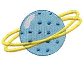 Planet machine embroidery design. Saturn embroidery design in filled stitch. Fun space embroidery for young space cadets.