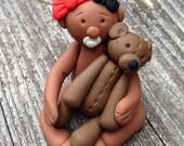 Polymer baby ornament with a teddybear