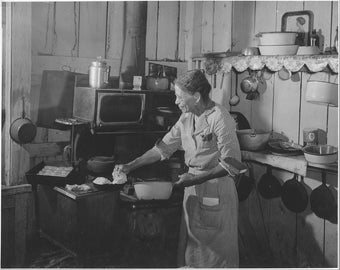 Image 8 1/2 x 11 suitable for framing. Black Americana woman cooking.