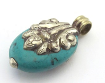 Tibetan turquoise gemstone silver floral design reversible pendant from Nepal  - PM198A