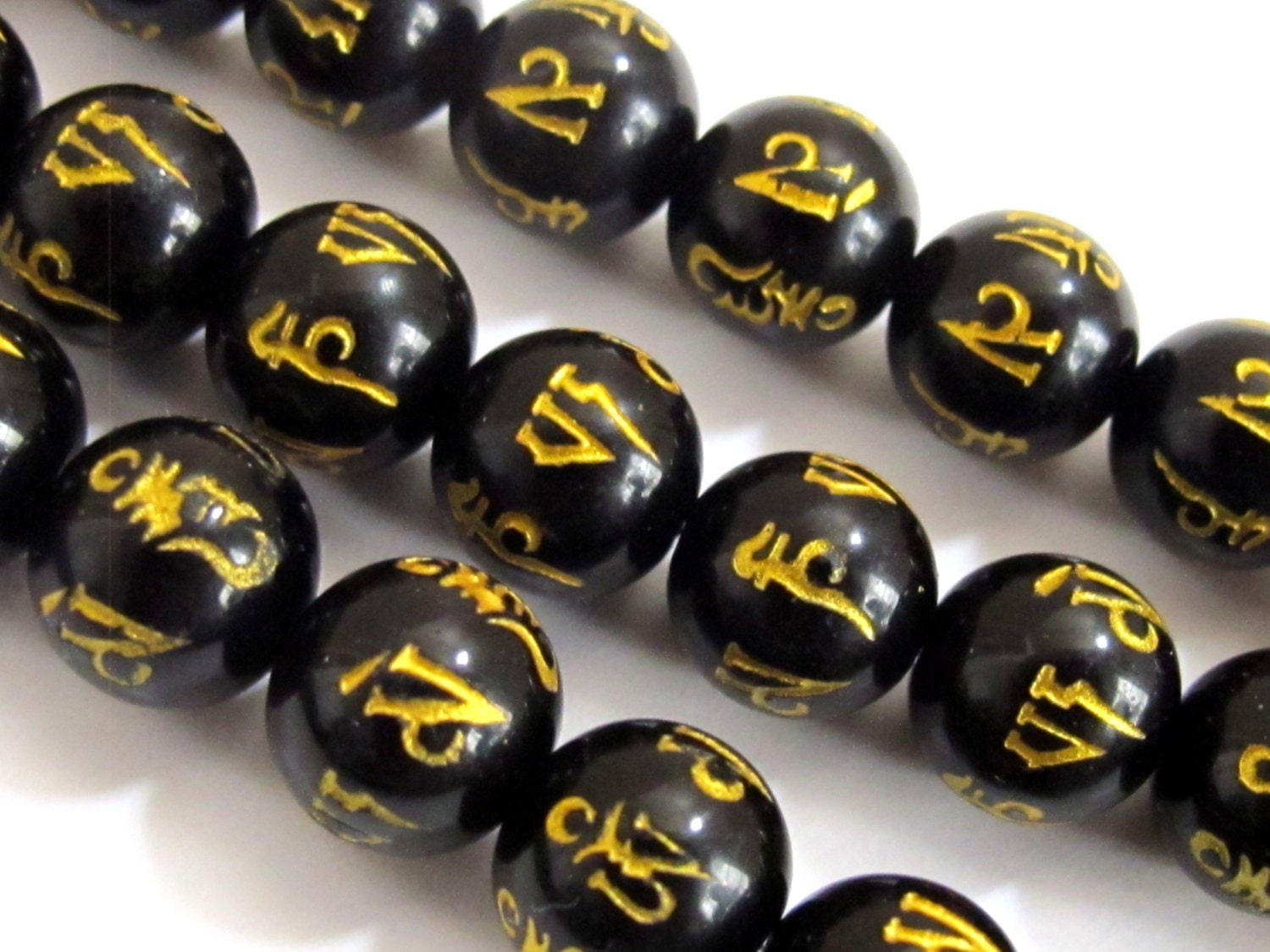 4 tibetan om mantra etched black agate quartz 10