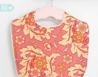 The Dressy Drooler Bib in pink and cream floral paisley print