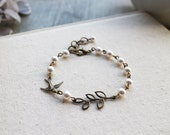 Leave Branch Bracelet. antique brass leaves, flying sparroe, and pearls. spring collection. bridesmaid gift. birthday gift