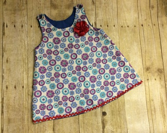 A-line style dress with embelished flower. Embroider this, add an initial